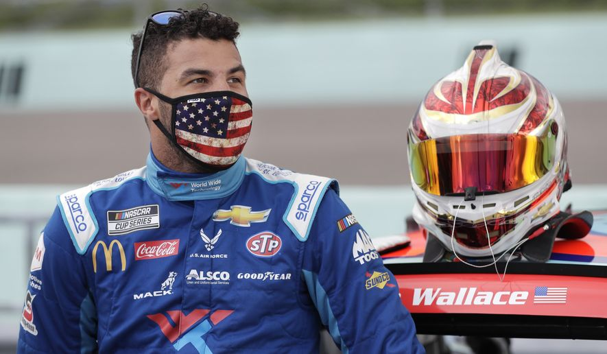 Bubba Wallace waits for the start of a NASCAR Cup Series auto race Sunday, June 14, 2020, in Homestead, Fla. (AP Photo/Wilfredo Lee) ** FILE **