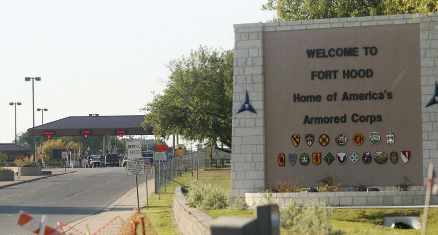 This Nov. 5, 2009, file photo shows the entrance to Fort Hood Army Base in Fort Hood, Texas, near Killeen, Texas. (AP Photo/Jack Plunkett, File)
