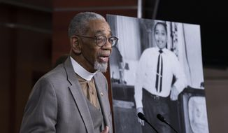 """Rep. Bobby Rush, D-Ill., speaks during a news conference about the """"Emmett Till Antilynching Act"""" which would designate lynching as a hate crime under federal law, on Capitol Hill in Washington, Wednesday, Feb. 26, 2020. Emmett Till, pictured at right, was a 14-year-old African-American who was lynched in Mississippi in 1955, after being accused of offending a white woman in her family's grocery store. (AP Photo/J. Scott Applewhite) ** FILE **"""