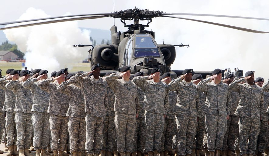 In this Friday, May 13, 2011, file photo, soldiers of 1AD attend a color casing ceremony of the First Armored Division at the US Army Airfield in Wiesbaden, Germany. After more than a year of thinly veiled threats that the United States could start pulling troops out of Germany unless the country increases its defense spending to NATO standards, President Donald Trump appears to be going ahead with the hardball approach with a plan to reduce the American military presence in the country by more than 25 percent. (AP Photo/Michael Probst, file)