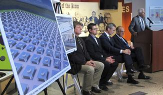 File - In this April 29, 2015, file photo, an illustration depicts a planned interim storage facility for spent nuclear fuel in southeastern New Mexico as officials announce plans to pursue the project during a news conference at the National Museum of Nuclear Science and History in Albuquerque, N.M. A proposed multibillion-dollar complex in southern New Mexico that would store spent nuclear fuel from commercial power plants around the U.S. is facing another legal challenge as opponents have filed an appeal in federal court. They are taking aim at the federal government's decision to dismiss numerous contentions that watchdogs had raised about the project. (AP Photo/Susan Montoya Bryan, File)
