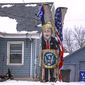 A tall tree stump painted with an image of President Trump and draped with an American flag makes a political point at a home in Iowa. (Associated Press)