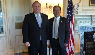 """Secretary of State Mike Pompeo says Miles Yu, born in China, is """"a central part of my team advising me with respect on how to ensure that we protect Americans and secure our freedoms in the face of challenges from the [Chinese Communist Party]."""" (State Department photograph)"""