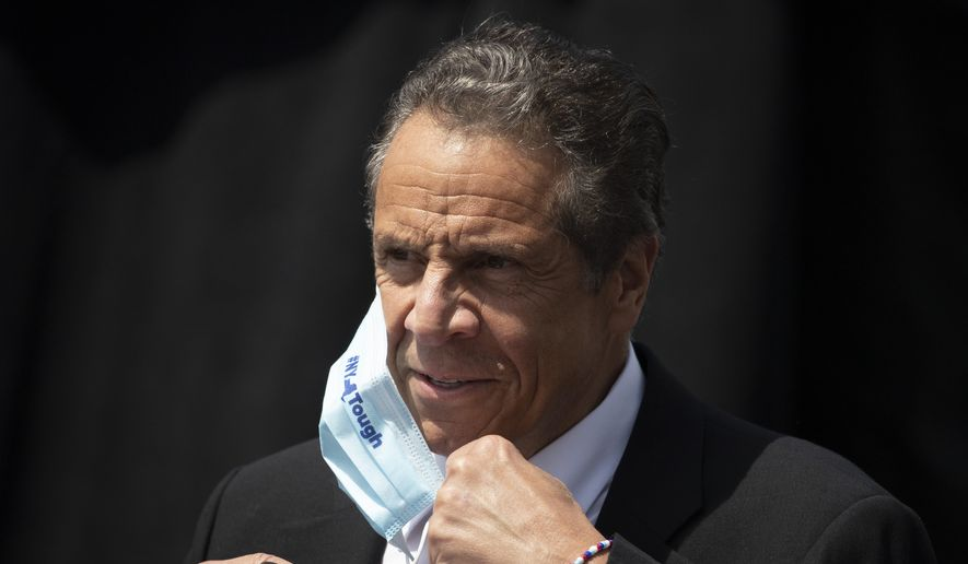 New York Gov. Andrew Cuomo removes a mask as he holds a news conference to announce the opening of a bicycle and pedestrian path across the Gov. Mario M. Cuomo Bridge, Monday, June 15, 2020, in Tarrytown, N.Y. (AP Photo/Mark Lennihan) ** FILE **