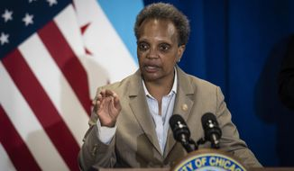 Mayor Lori Lightfoot speaks during a press conference at City Hall to announce the city's new Use of Force Working Group, designed to to review the Chicago Police Department's policies pertaining to use of force, Monday morning, June 15, 2020. (Ashlee Rezin Garcia/Chicago Sun-Times via AP)