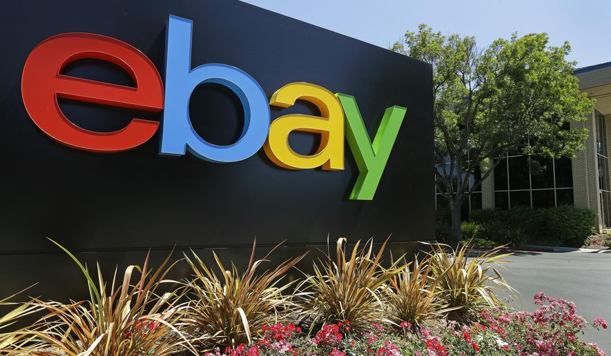 FILE - This Tuesday, July 16, 2013, file photo shows signage at eBay headquarters in San Jose, Calif. Six former eBay Inc. employees were arrested and charged Monday, June 15, 2020, with waging an extensive campaign to terrorize and intimidate the editor and publisher of an online newsletter with threats and disturbing deliveries to their home, including live spiders and cockroaches. (AP Photo/Ben Margot, File)