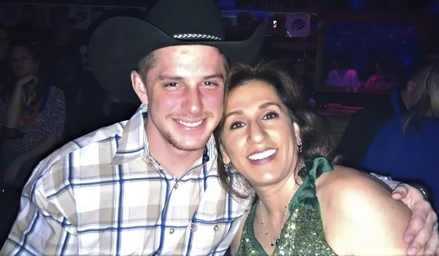 This image provided by Joey Reed, shows Trevor Reed and his mom Paula Reed in 2014 in Arlington, Texas. (Joey Reed via AP)