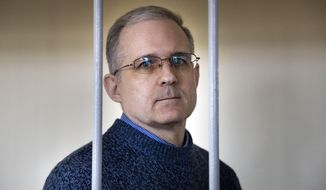 In this Aug. 23, 2019, file photo, Paul Whelan, a former U.S. marine who was arrested for alleged spying in Moscow on Dec. 28, 2018, stands in a cage as he waits for a hearing in a court room in Moscow, Russia. The Moscow City Court on Monday June 15, 2020, convicted Paul Whelan on charges of espionage and sentenced him to 16 years in maximum security prison colony. Whelan has insisted on his innocence, saying he was set up. (AP Photo/Alexander Zemlianichenko. File)