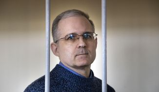 In this Aug. 23, 2019, file photo, Paul Whelan, a former U.S. Marine who was arrested for alleged spying in Moscow on Dec. 28, 2018, speaks while standing in a cage as he waits for a hearing in a courtroom in Moscow, Russia. (AP Photo/Alexander Zemlianichenko, File)