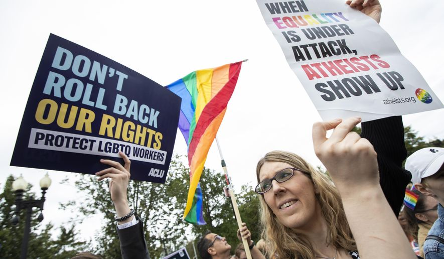 In this Oct. 8, 2019, file photo, transgender woman Alison Gill from Maryland, joins LGBT supporters in front of the U.S. Supreme Court, Tuesday, Oct. 8, 2019, in Washington. The Supreme Court has ruled that a landmark civil rights law protects gay, lesbian and transgender people from discrimination in employment. It's a resounding victory for LGBT rights from a conservative court. (AP Photo/Manuel Balce Ceneta, File)