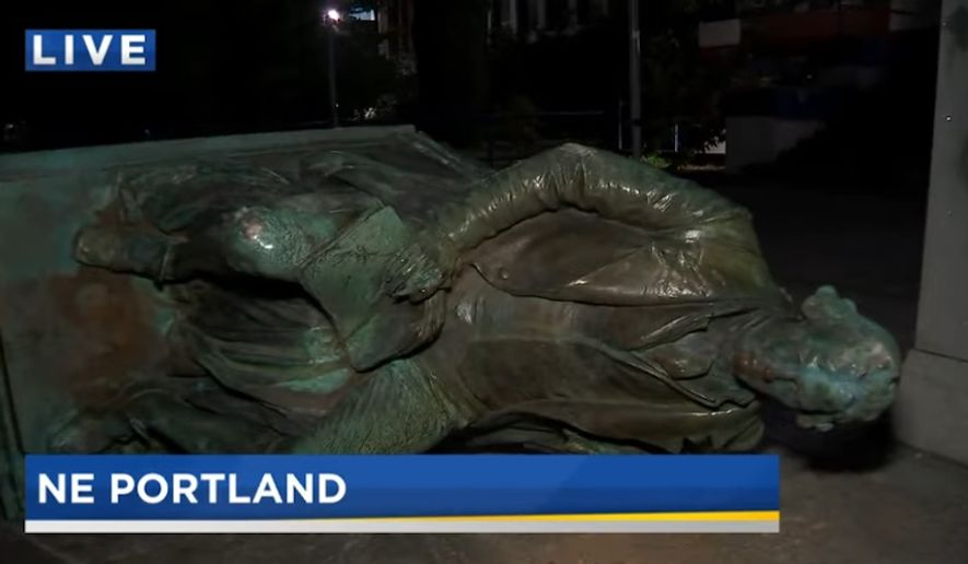Protesters toppled a statue of Thomas Jefferson in front of a high school Sunday night following a Black Lives Matter demonstration in Portland, Oregon. (Screengrab via KPTV)