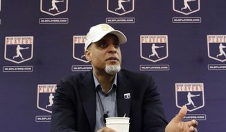 In this Feb. 19, 2017, file photo, Major League Players Association Executive Director Tony Clark, answers questions at a news conference in Phoenix. Commissioner Rob Manfred says there might be no major league season after a breakdown in talks between teams and the union on how to split up money in a season delayed by the coronavirus pandemic. The league also said several players have tested positive for COVID-19. Two days after union head Clark declared additional negotiations futile, Deputy Commissioner Dan Halem sent a seven-page letter to players' association chief negotiator Bruce Meyer asking the union whether it will waive the threat of legal action and tell MLB to announce a spring training report date and a regular season schedule. (AP Photo/Morry Gash, File)  **FILE**