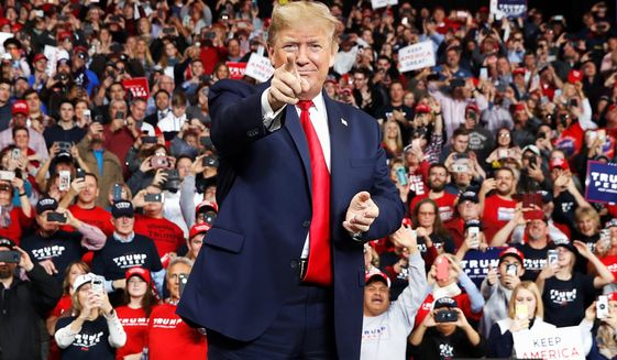 It's all systems go for a massive campaign rally for President Trump in Tulsa, Oklahoma, on Saturday. His fans began lining up on Monday. (Associated Press)