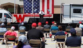 """I know you had to shut down but you opened right back up,"" Vice President Mike Pence said at the Winnebago plant in Forest City, Iowa, on Tuesday. (Associated Press)"
