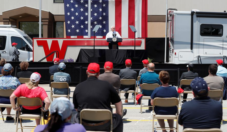"""""""I know you had to shut down but you opened right back up,"""" Vice President Mike Pence said at the Winnebago plant in Forest City, Iowa, on Tuesday. (Associated Press)"""