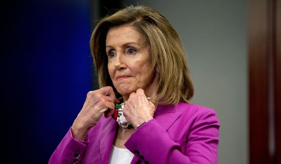 House Speaker Nancy Pelosi of Calif., puts her mask back on after speaking at a news conference on District of Columbia statehood on Capitol Hill, Tuesday, June 16, 2020, in Washington. House Majority Leader Steny Hoyer of Md. will hold a vote on D.C. statehood on July 26. (AP Photo/Andrew Harnik) **FILE**