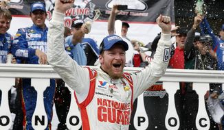 In this Aug. 3, 2014, file photo, Dale Earnhardt Jr. celebrates in Victory Lane after winning a NASCAR Sprint Cup Series auto race at Pocono Raceway in Long Pond, Pa. Longtime fan favorite Dale Earnhardt Jr. is the marquee name on NASCAR's 2021 Hall of Fame class, announced Tuesday, June 16, 2020. (AP Photo/Matt Slocum, File)  **FILE**