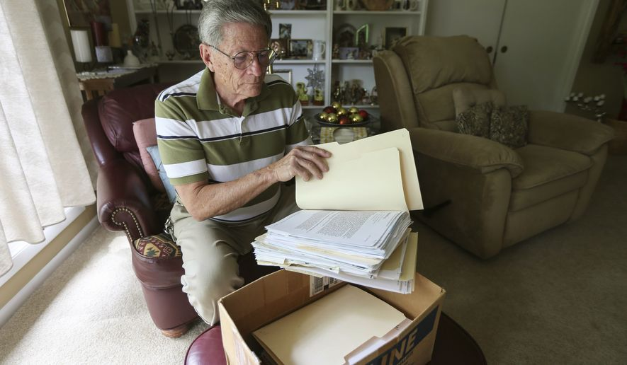 Fred Haines of Wichita, Kansas, was the victim of elaborate financial schemes a decade ago and is still paying on the debt he incurred.  (Travis Heying /The Wichita Eagle via AP)