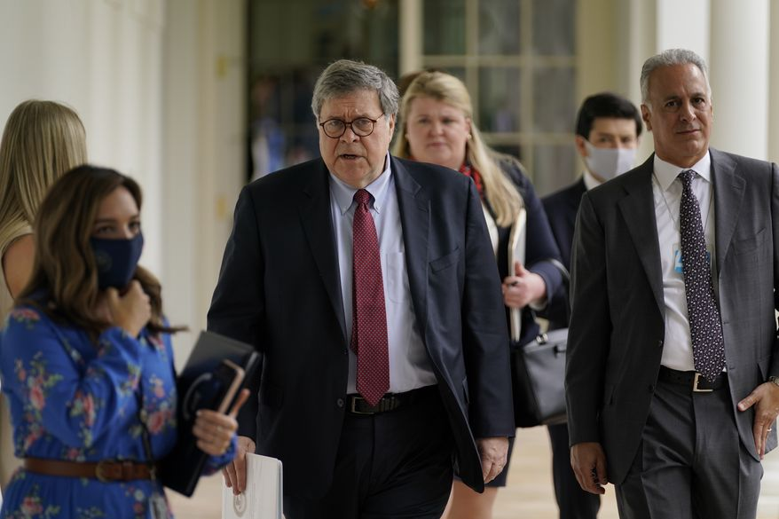 Attorney General William Barr, center,arrives for an event on police reform, in the Rose Garden of the White House, Tuesday, June 16, 2020, in Washington. (AP Photo/Evan Vucci)