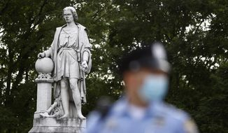 In this file photo, a Philadelphia police officer stands near the statue of Christopher Columbus at Marconi Plaza, Monday, June 15, 2020, in the South Philadelphia neighborhood of Philadelphia. (AP Photo/Matt Slocum)  **FILE**