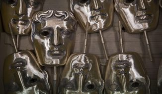 FILE - In this Tuesday, Jan. 31, 2020 file photo, bronze alloy masks lie in a foundry in West Drayton, Middlesex,  ahead of the awards ceremony in February. Next year's British Academy Film Awards have been postponed by two months, organizers said Tuesday, June 16, 2020. The move follows a decision by Hollywood's film academy to shift the 2021 Oscars from February to April because of the coronavirus pandemic. (Photo by Joel Ryan/Invision/AP, File)