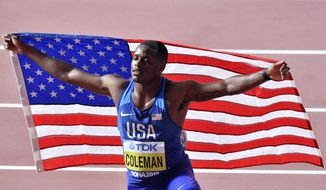 In this Sept. 28, 2019, file photo, Christian Coleman, of the United States, poses after winning the men's 100 meter race during the World Athletics Championships in Doha, Qatar. Reigning world champion Coleman insists a simple phone call from drug testers while he was out Christmas shopping could've prevented the latest misunderstanding about his whereabouts, one he fears could lead to a suspension. (AP Photo/Martin Meissner, File)  **FILE**