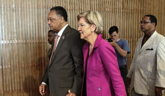 In this June 29, 2019, file photo, the Rev. Jesse Jackson walks with Sen. Elizabeth Warren, D-Mass., as they attend the Rainbow PUSH Coalition International Convention at Apostolic Faith Church in Chicago. (Kevin Tanaka/Chicago Sun-Times via AP, File)
