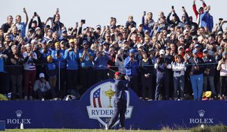 FILE - In a Sunday, Sept. 30, 2018 file photo, Tiger Woods plays a shot from the 4th tee during a singles match on the final day of the 42nd Ryder Cup at Le Golf National in Saint-Quentin-en-Yvelines, outside Paris, France. A decision is looming whether to play the Ryder Cup in Wisconsin in September 2020 with fans or even postpone it until next year. (AP Photo/Alastair Grant, File)