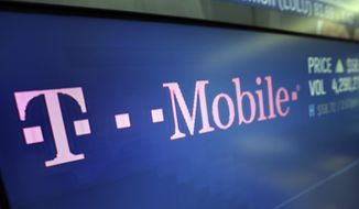 """In this Feb. 14, 2018, photo, the logo for T-Mobile appears on a screen at the Nasdaq MarketSite in New York. T-Mobile, one of the three largest mobile carriers in the U.S., said it's working to fix a widespread network issue. The company's president of technology, Neville Ray, tweeted Monday afternoon, June 15, 2020, at around 4 p.m. Eastern Daylight Time that T-Mobile engineers hope to fix the """"voice and data issue"""" soon. (AP Photo/Richard Drew)"""