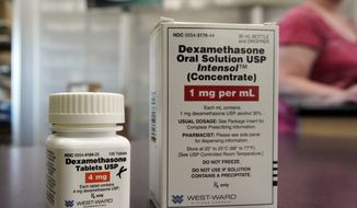 Packages of dexamethasone are displayed in a pharmacy, Tuesday, June 16, 2020,  in Omaha, Neb. Researchers in England said Tuesday they have the first evidence that the drug can improve COVID-19 survival. The cheap, widely available steroid called dexamethasone reduced deaths by up to one third in severely ill hospitalized patients. (AP Photo/Nati Harnik)