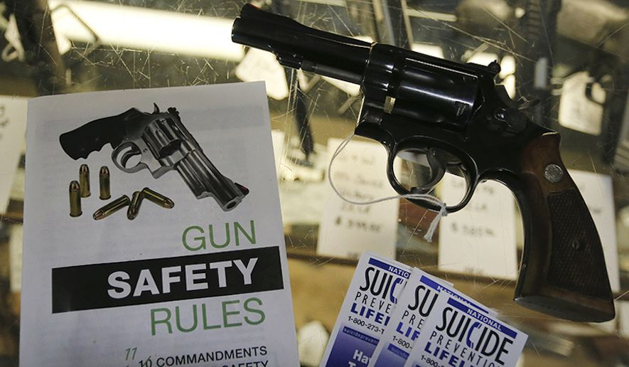 Gun safety and suicide prevention brochures are on display next to guns for sale at a local retail gun store in Montrose, Colo. (AP Photo/Brennan Linsley) ** FILE **