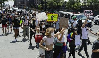 Protesters gather as part of a solidarity rally calling for justice over the death of George Floyd, and to highlight police brutality nationwide, Wednesday, June 17, 2020, in the Brooklyn borough of New York. (AP Photo/Frank Franklin II) ** FILE **