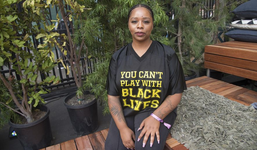 """In this Nov. 4, 2018, file photo, Patrisse Cullors poses for a photo on day three of Summit LA18 in Los Angeles. """"I'm really proud of the work we've been able to do in the last seven years,"""" Cullors, co-founder and chairwoman of the Black Lives Matter Global Network Foundation, said in a statement. """"What is clear is that Black Lives Matter shares a name with a much larger movement and there are literally hundreds of organizations that do impactful racial and gender justice work who make up the fabric of this broader movement."""" (Photo by Amy Harris/Invision/AP, File)"""