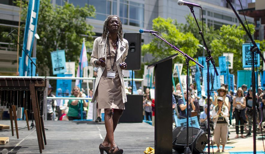 In this June 4, 2019, file photo, Portland Commissioner Jo Ann Hardesty spoke as several hundred people gathered in Director Park in Portland, Ore., at a rally in support of a climate change lawsuit. (Dave Killen/The Oregonian via AP, File)