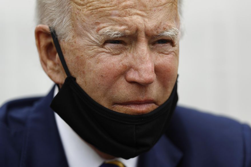 Democratic presidential candidate, former Vice President Joe Biden listens as he meets with small business owners, Wednesday, June 17, 2020, at Carlette's Hideaway, a soul food restaurant, in Yeadon, Pa. (AP Photo/Matt Slocum)