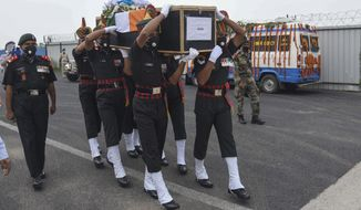 Indian army soldiers carry the coffin of their colleague Sunil Kumar, killed during confrontation with Chinese soldiers in the Ladakh region, as the body was brought to Jai Prakash Narayan airport, in Patna, Bihar state, India, Wednesday, June 17, 2020. Twenty Indian troops were reportedly killed, in the clash in the Ladakh region late Monday that was the first deadly confrontation on the disputed border between India and China since 1975. (AP Photo/Aftab Alam Siddiqui)