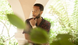 """In this June 13, 2020 photo, singer-songwriter John Legend appears during a photo session at The Bel Air Hotel in Beverly Hills, Calif., to promote his latest album """"Bigger Love."""" (Photo by Rebecca Cabage/Invision/AP)"""