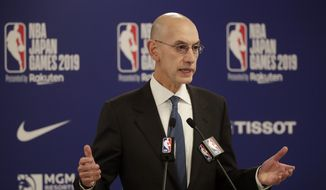 In this Oct. 8, 2019, file photo, NBA Commissioner Adam Silver speaks at a news conference before an NBA preseason basketball game between the Houston Rockets and the Toronto Raptors in Saitama, near Tokyo. It's been over three months since the commissioners of major sports cancelled or postponed events because of the coronavirus. Enough time for us to grade them on how they've handled the virus so far. (AP Photo/Jae C. Hong, File)  **FILE**