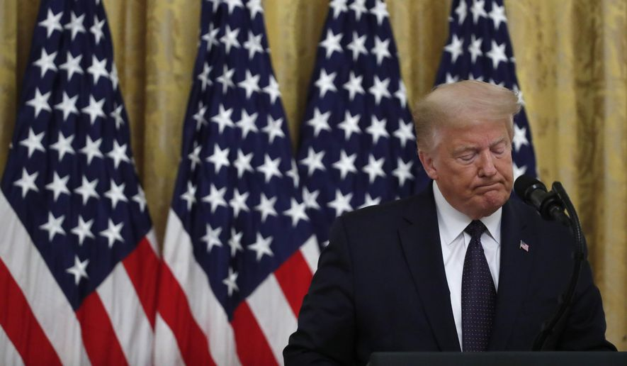 """President Donald Trump pauses as he speaks about the PREVENTS """"President's Roadmap to Empower Veterans and End a National Tragedy of Suicide,"""" task force, in the East Room of the White House, Wednesday, June 17, 2020, in Washington. (AP Photo/Alex Brandon)"""