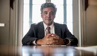 FILE - In this May 21, 2019, file photo, Solicitor General Noel Francisco poses for a photograph at the Department of Justice in Washington. Francisco, who as the Trump administration's top Supreme Court lawyer defended controversial policies including the president's travel ban, push to add a citizenship question to the census and decision to restrict service in the military by transgender people, is leaving the job. (AP Photo/Andrew Harnik, File)