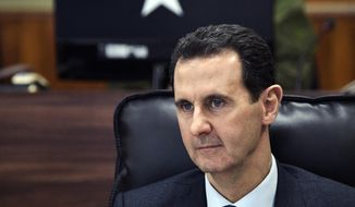 The Trump administration is ramping up pressure on Syrian President Bashar Assad and his inner circle with a raft of new economic and travel sanctions for human rights abuses. (Alexei Nikolsky, Sputnik, Kremlin Pool Photo via AP)