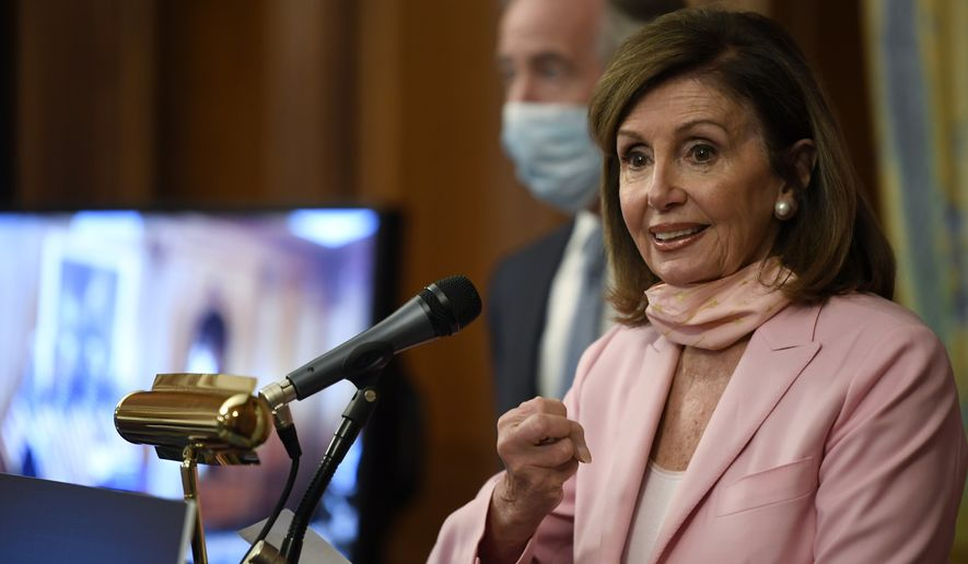 House Speaker Nancy Pelosi of Calif., right, standing next to Rep. Richard Neal, D-Mass., left, speaks during an event on Capitol Hill in Washington, Thursday, June 18, 2020. They unveiled the Moving Forward Act, which aims to rebuild America's infrastructure. (AP Photo/Susan Walsh) **FILE**