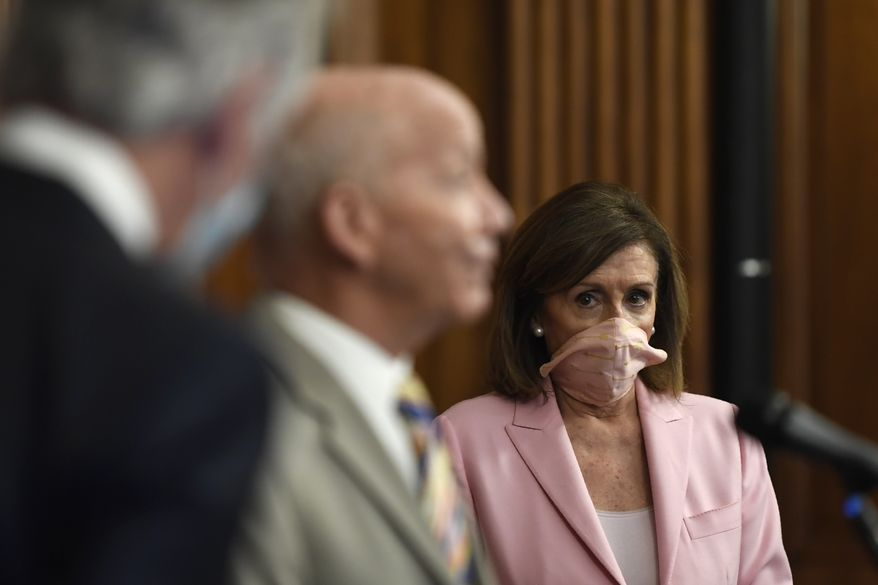 House Speaker Nancy Pelosi of Calif., right, listens as Rep. Peter DeFazio, D-Ore., center, speaks during an event on Capitol Hill in Washington, Thursday, June 18, 2020. They unveiled the Moving Forward Act, which aims to rebuild America's infrastructure. (AP Photo/Susan Walsh)