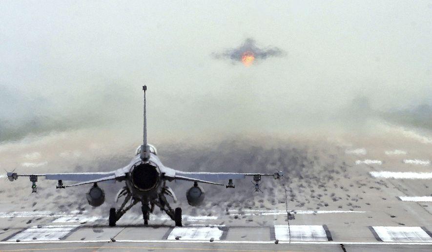 In this file photo, a U.S. Air Force F-16 fighter jet prepares to take off at the Osan U.S. Air Base in Pyeongtaek, South Korea, Thursday, June 18, 2020. (Hong Ki-won/Yonhap via AP)  **FILE**