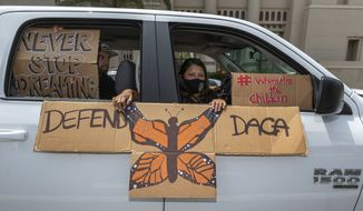 An immigrant family joins members of Coalition for Humane Immigrant Rights of Los Angeles, CHIRLA, on a vehicle caravan rally to support the Deferred Action for Childhood Arrivals Program (DACA), around MacArthur Park in Los Angeles, Thursday, June 18, 2020. (AP Photo/Damian Dovarganes) ** FILE **