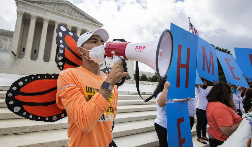 Deferred Action for Childhood Arrivals (DACA) recipient Roberto Martinez, left, celebrates in front of the Supreme Court after the Supreme Court rejected President Donald Trump's effort to end legal protections for young immigrants, Thursday, June 18, 2020, in Washington. (AP Photo/Manuel Balce Ceneta)