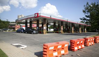"""In this Wednesday, June 17, 2020, photo, barricades sit in front of QuikTrip at 15th and Denver in Tulsa, Okla. The QuikTrip convenience store chain announced the closing of its downtown area locations """"out of possible safety concerns for our employees."""" Tens of thousands of Trump supporters are expected in Tulsa Saturday for the first of a series of rallies across the country to rev up his reelection campaign. Tulsa experienced several days of large protests after the death of black resident George Floyd. (Ian Maule/Tulsa World via AP)"""