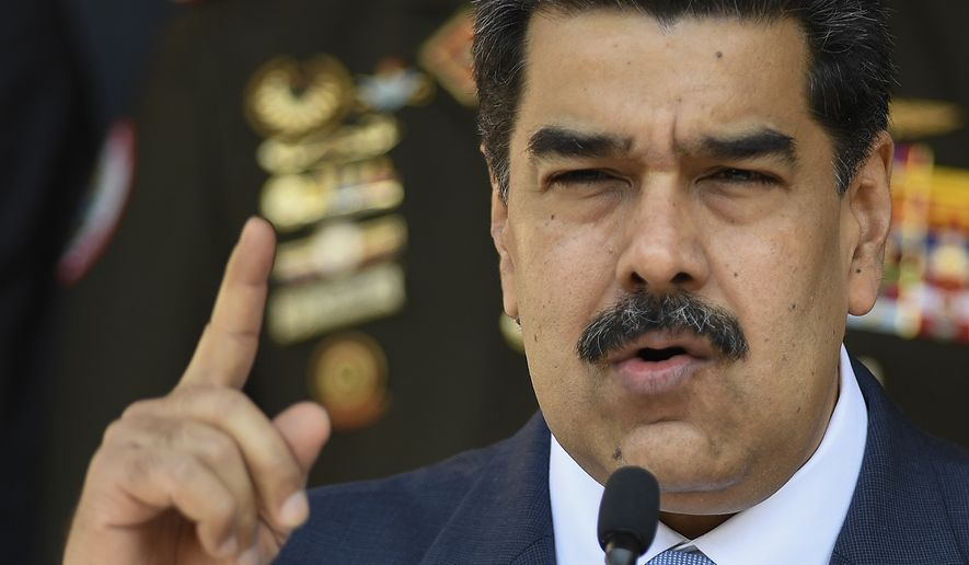 In this March 12, 2020, file photo, Venezuelan President Nicolas Maduro gives a press conference at Miraflores presidential palace in Caracas, Venezuela. The Trump administration increased pressure on Venezuelan Maduro, Thursday, June 18, targeting a lifeline he's used for selling crude oil run by a close associate of the socialist leader who was recently jailed in Cape Verde. (AP Photo/Matias Delacroix, File)