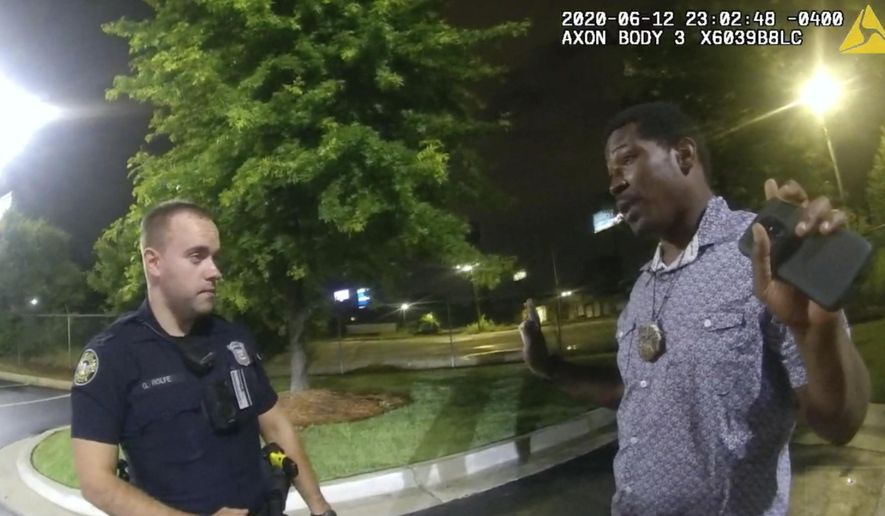 In this June 12, 2020 file photo from a screen grab taken from body camera video provided by the Atlanta Police Department Rayshard Brooks speaks with Officer Garrett Rolfe in the parking lot of a Wendy's restaurant, in Atlanta. (Atlanta Police Department via AP, File)