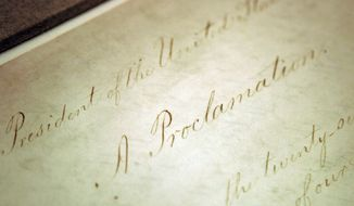 This Feb. 18, 2005, file photo shows the original Emancipation Proclamation on display in the Rotunda of the National Archives in Washington. President Abraham Lincoln first issued the Emancipation Proclamation declaring all slaves free in Confederate territory on Sept. 22, 1862. Juneteenth, the oldest holiday that commemorates the ending of slavery in the United States, originated 155 years ago.  Celebrations have typically included parades, barbecues, concerts and readings of the Emancipation Proclamation. (AP Photo/Evan Vucci, File)
